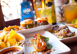 Small plates and margaritas at Peso's Kitchen & Lounge. Photo source.